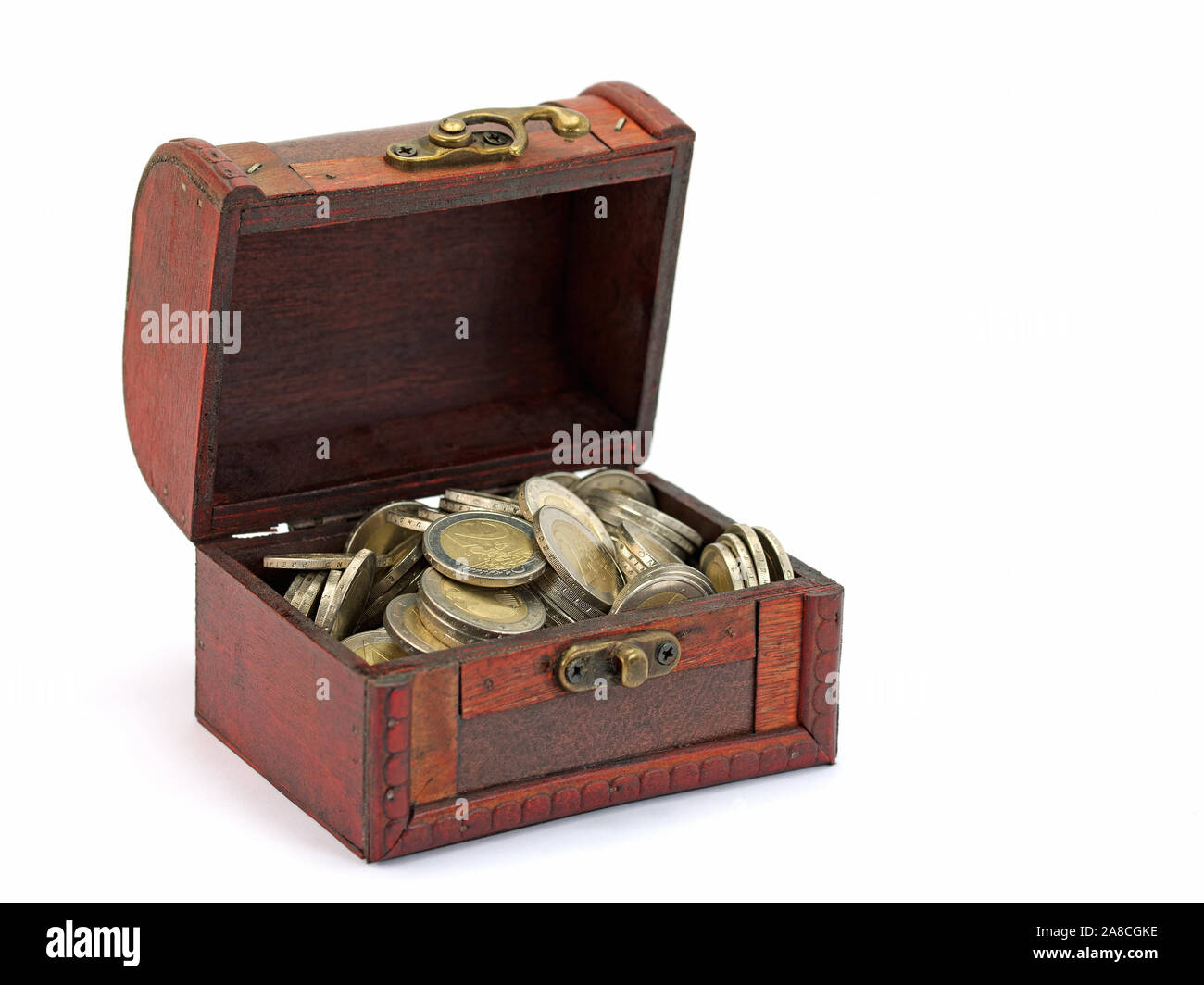 Wooden box with coins in front of white background Stock Photo