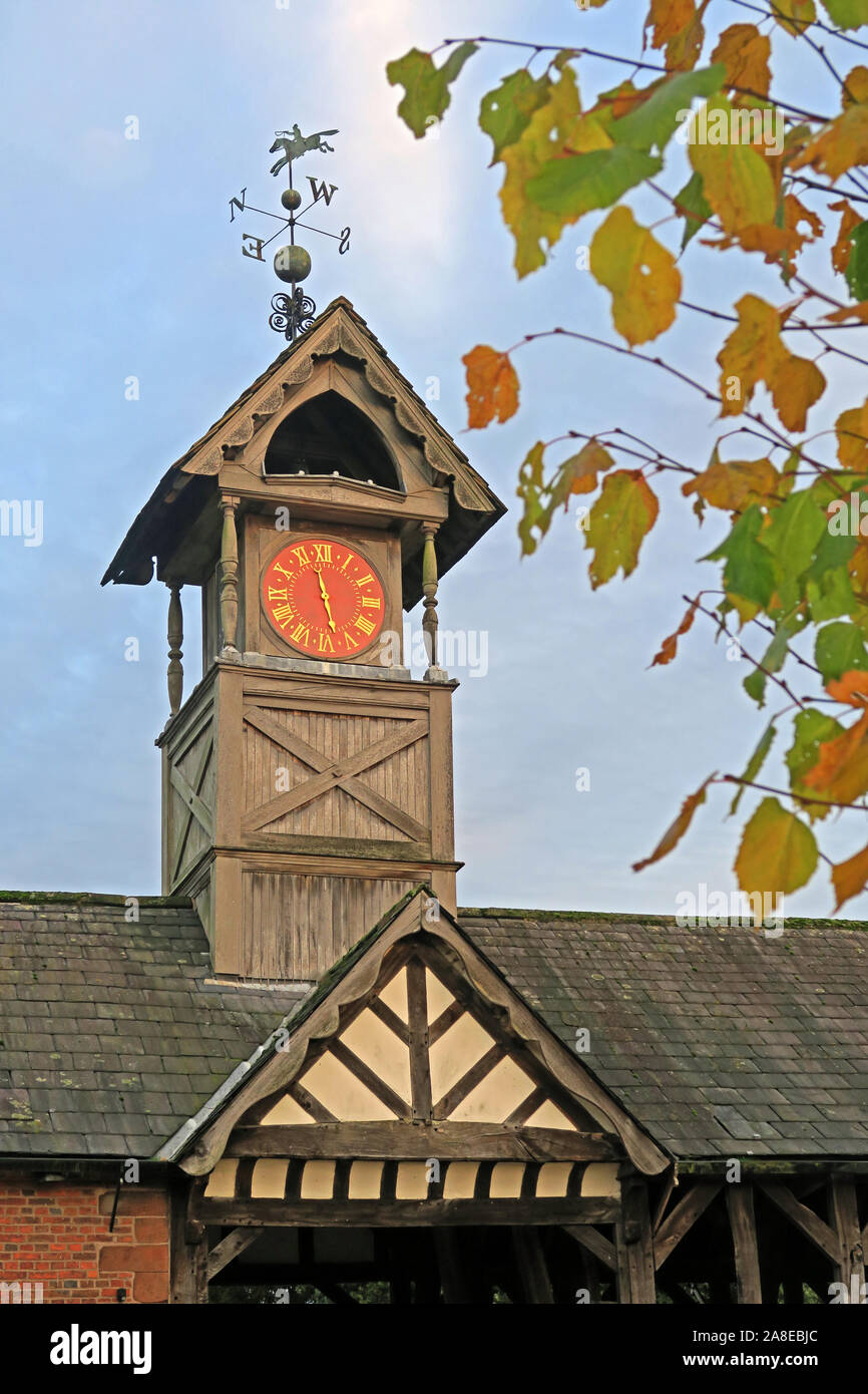 19th Century timber framed Clock Tower at Arley Hall, Arley Village, Warrington, Cheshire, England, UK, in autumn Stock Photo