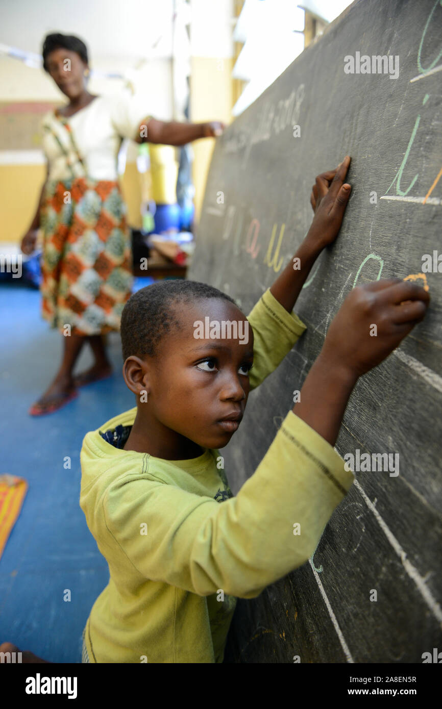 TOGO, Lome, centre with Kindergarten for children of porter market women, day care with education Stock Photo
