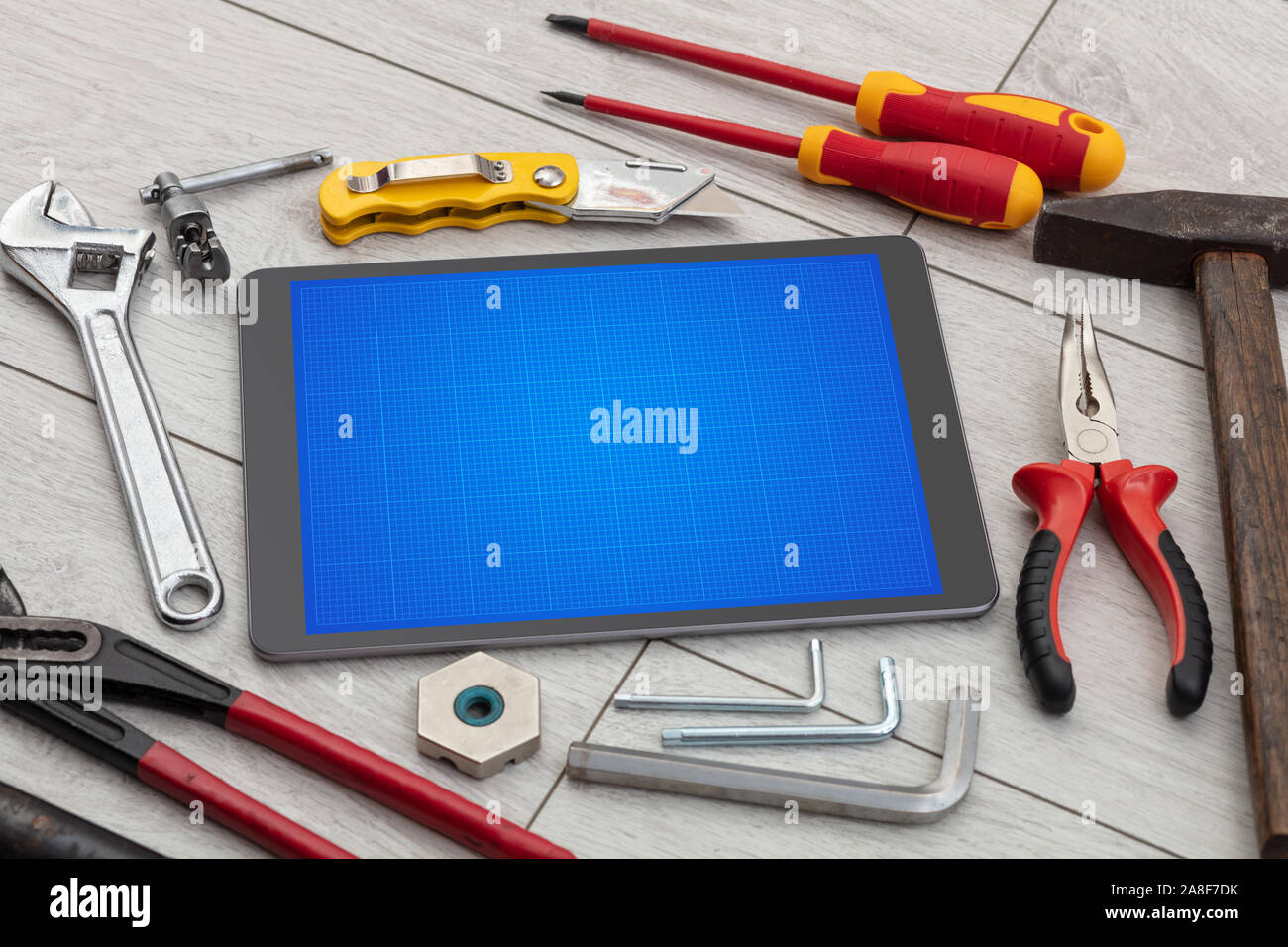 Household tools and tablet with grid screen concept Stock Photo