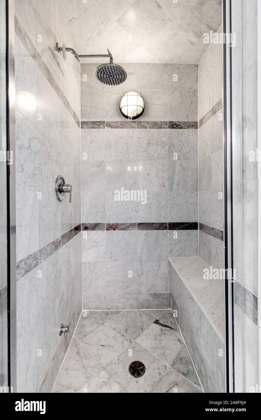 A Luxury Stand Up Grey Marble Shower With A Rain Shower Head With Accent Tiles Around The Edge And A Seat Stock Photo Alamy