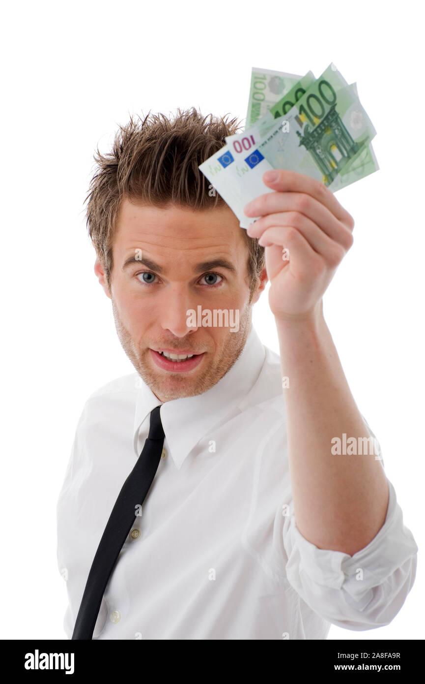 Mann, 25, 30, Jahre, Gecshäftsmann, hält Euro Banknoten in der Hand, Prämie, Bonus, Bestechung, Abgaben, Steuern, MR:Yes Stock Photo