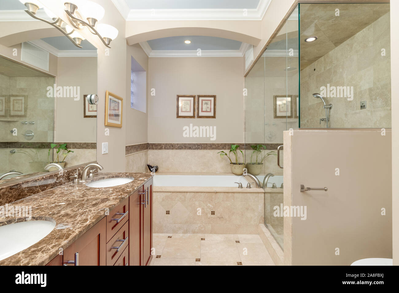 A Luxurious Bathroom With Brown Walls A Large Stand Up