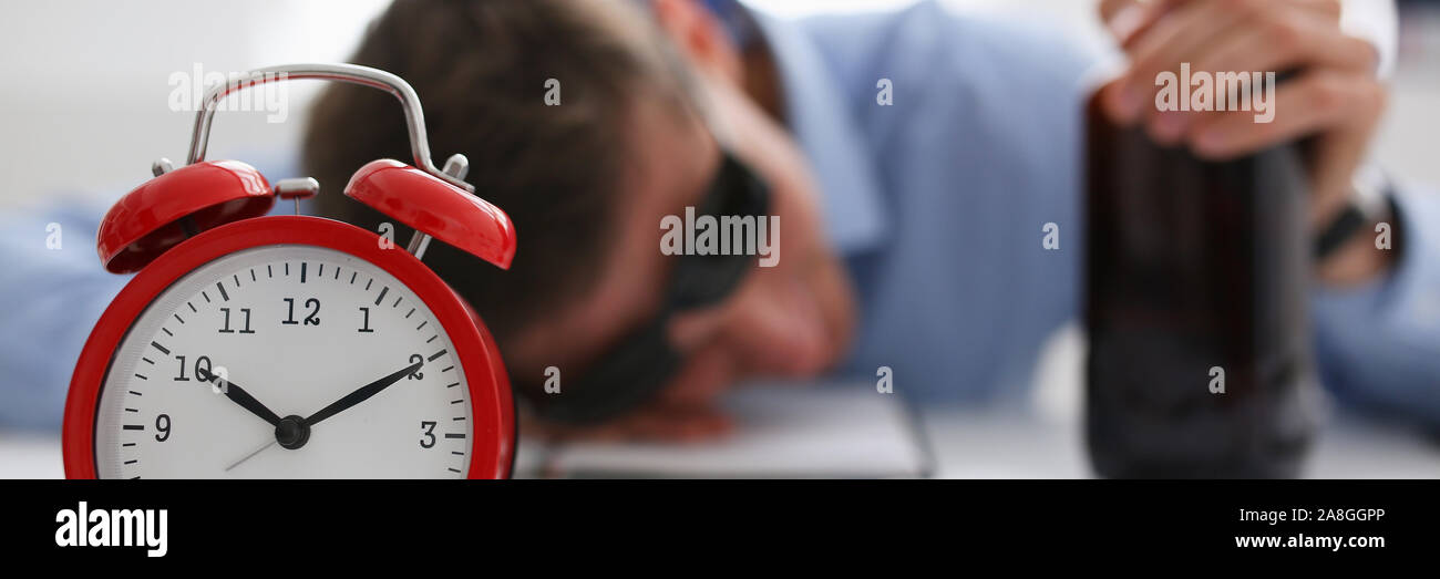 Businessman in blue shirt asleep at work on the Stock Photo