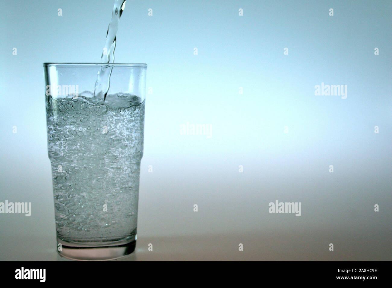 Ein Glas mit Wasser, Stock Photo