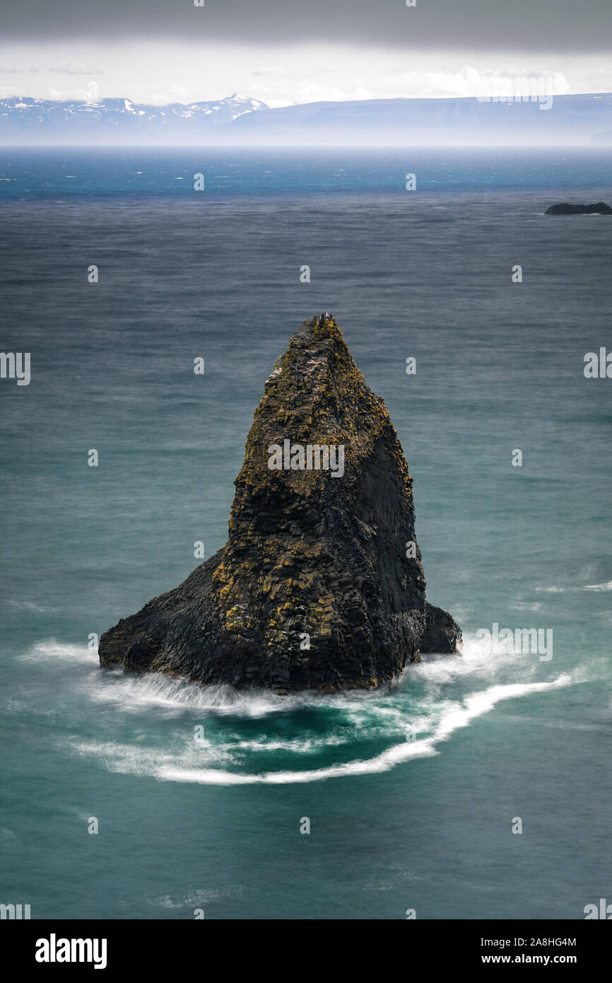 This is a wonderful sea stack of the remote Westfjords in Iceland Stock Photo