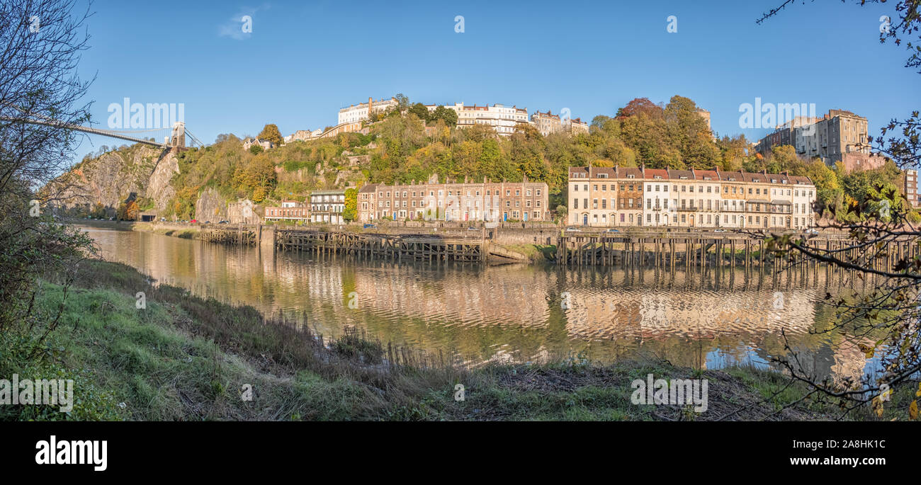 The Clifton Suspension Bridge, Wooden Wharfs, Hotwells and the Avon Gorge from the Leigh Woods side of the River Avon on a Sunny Evening, Bristol, UK Stock Photo