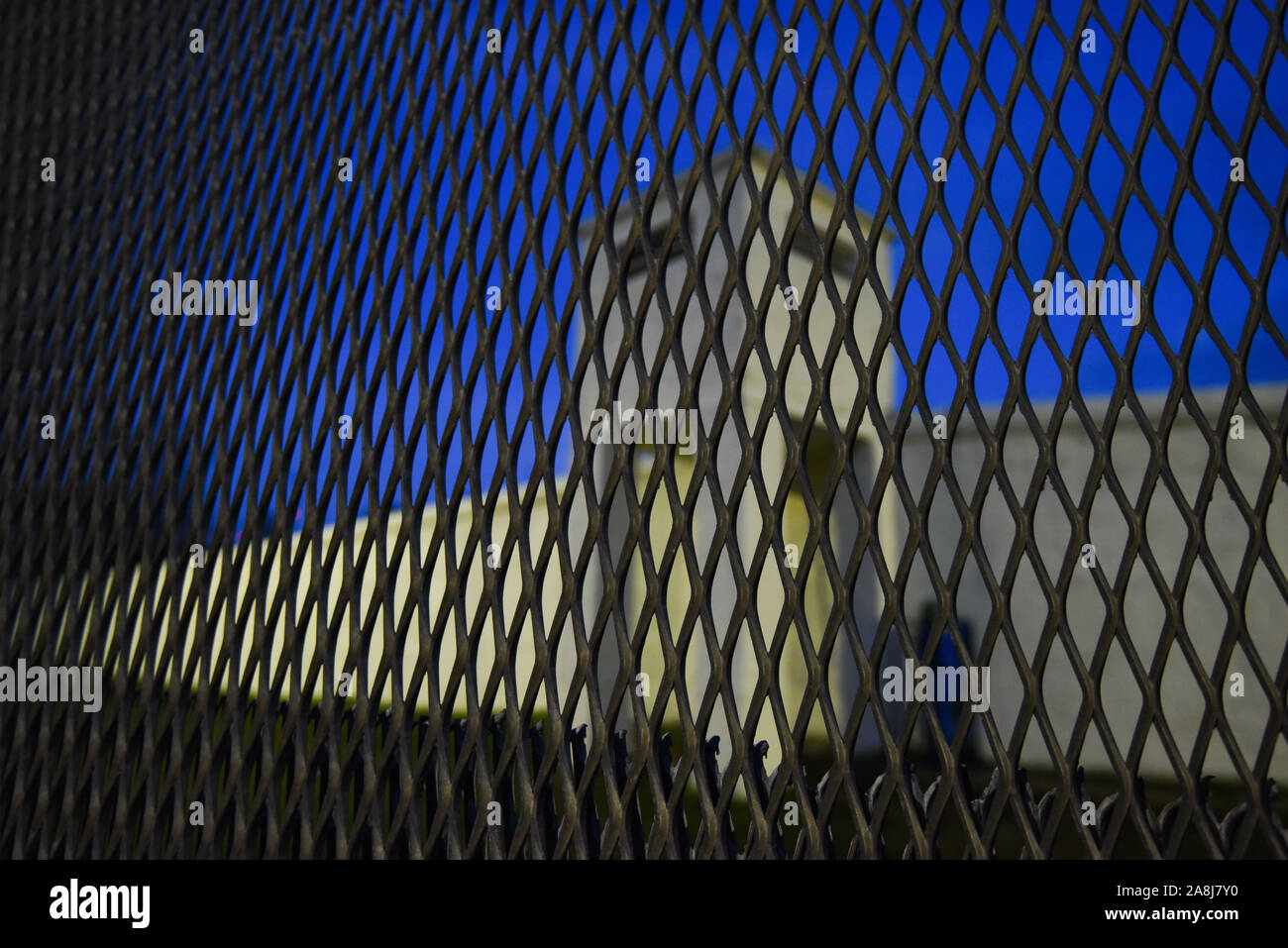 """09 November 2019, Bavaria, Mödlareuth: The piece of wall in the Deutsch-Deutschen Museum is illuminated at the blue hour. The festivities to mark the 30th anniversary of the fall of the Berlin Wall were held under the motto """"The Trabants are coming."""". Photo: Nicolas Armer/dpa Stock Photo"""