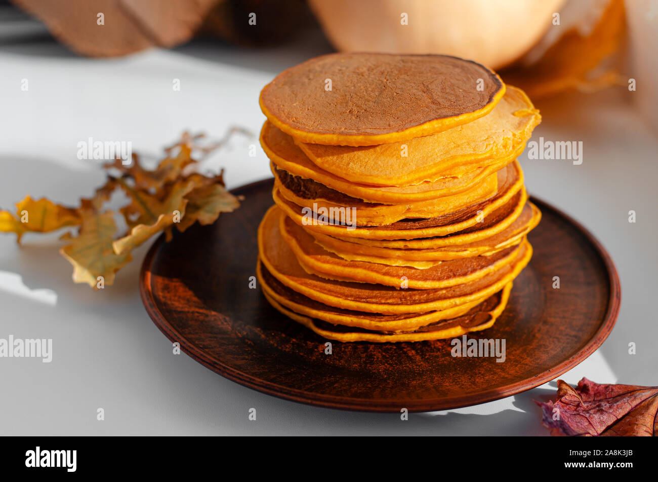 Stack of delicious pancakes on a brown plate. Autumn healthy food. Stock Photo