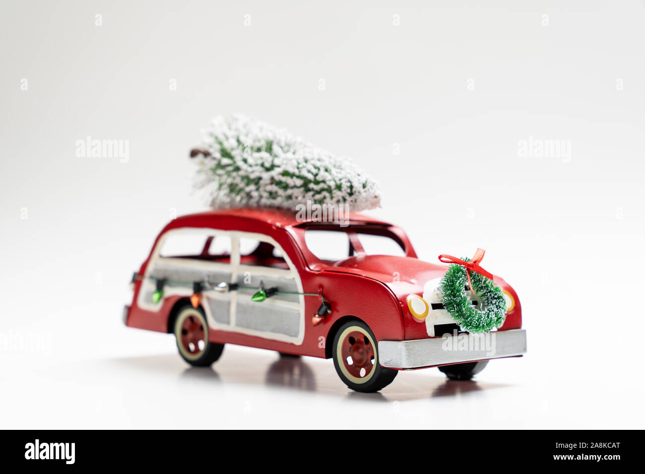 Little Red Vintage Car Carrying A Christmas Tree On Top Stock Photo Alamy
