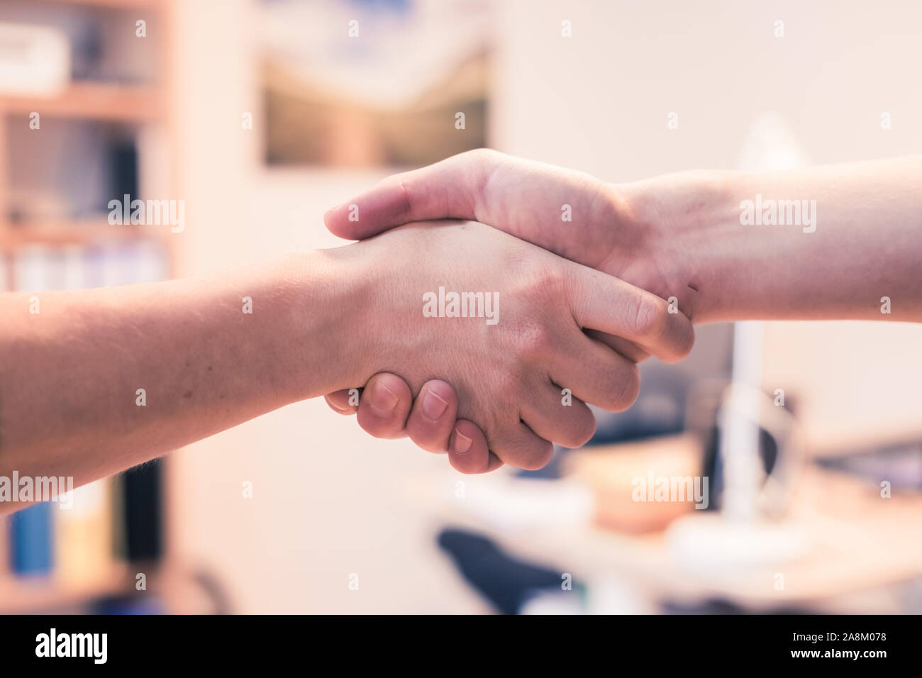 Man and woman are shaking hands, close up image, concept for human relationships Stock Photo