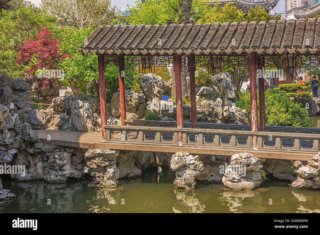 Editorial: SHANGHAI, CHINA, April 18, 2019 - Covered bridge over a pond in the Yuyuan Garden in Shanghai Stock Photo