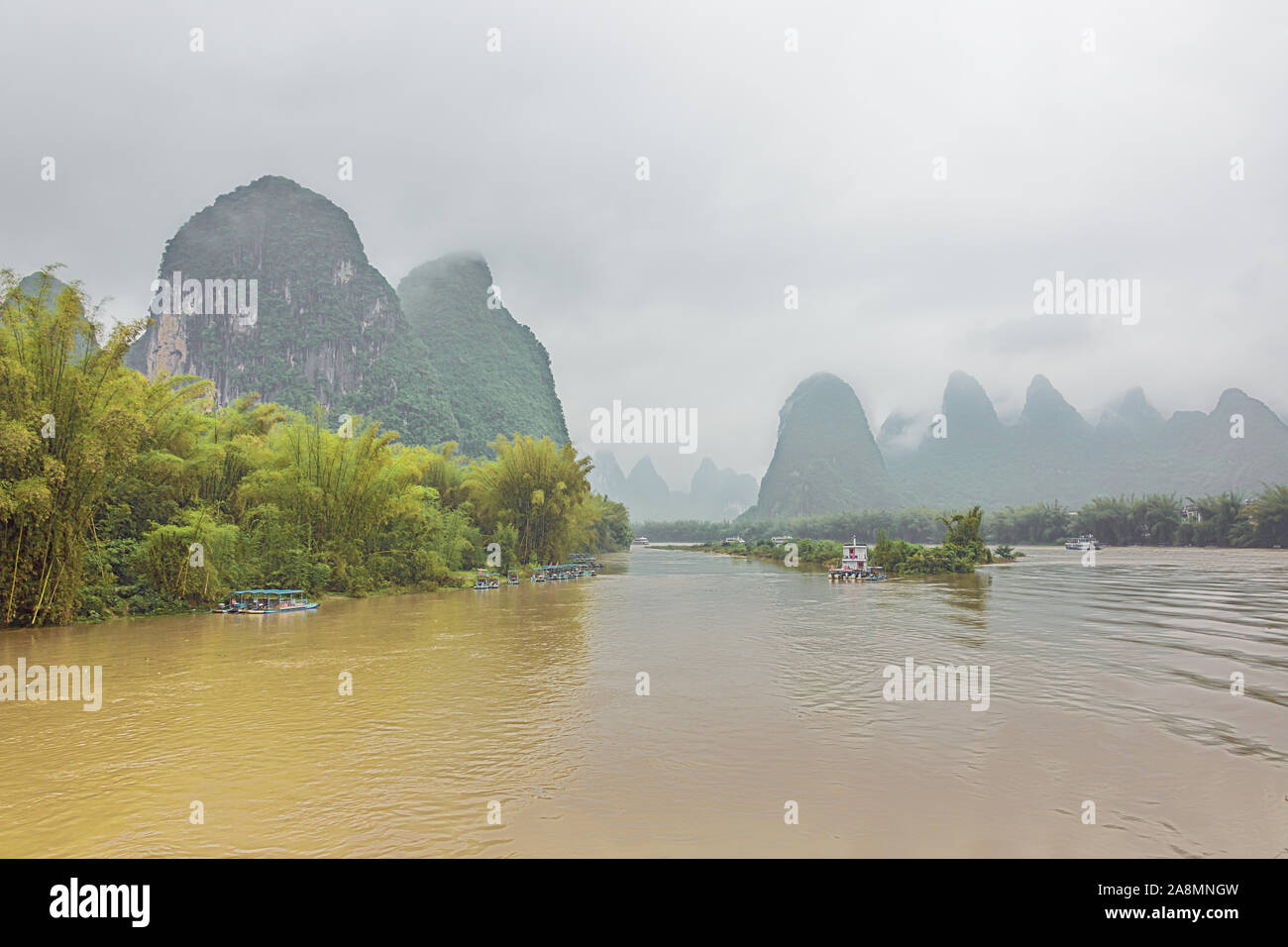 Several small boats at Xingpingzhen fishing village in the vicinity of Yangshuo near Guilin Stock Photo