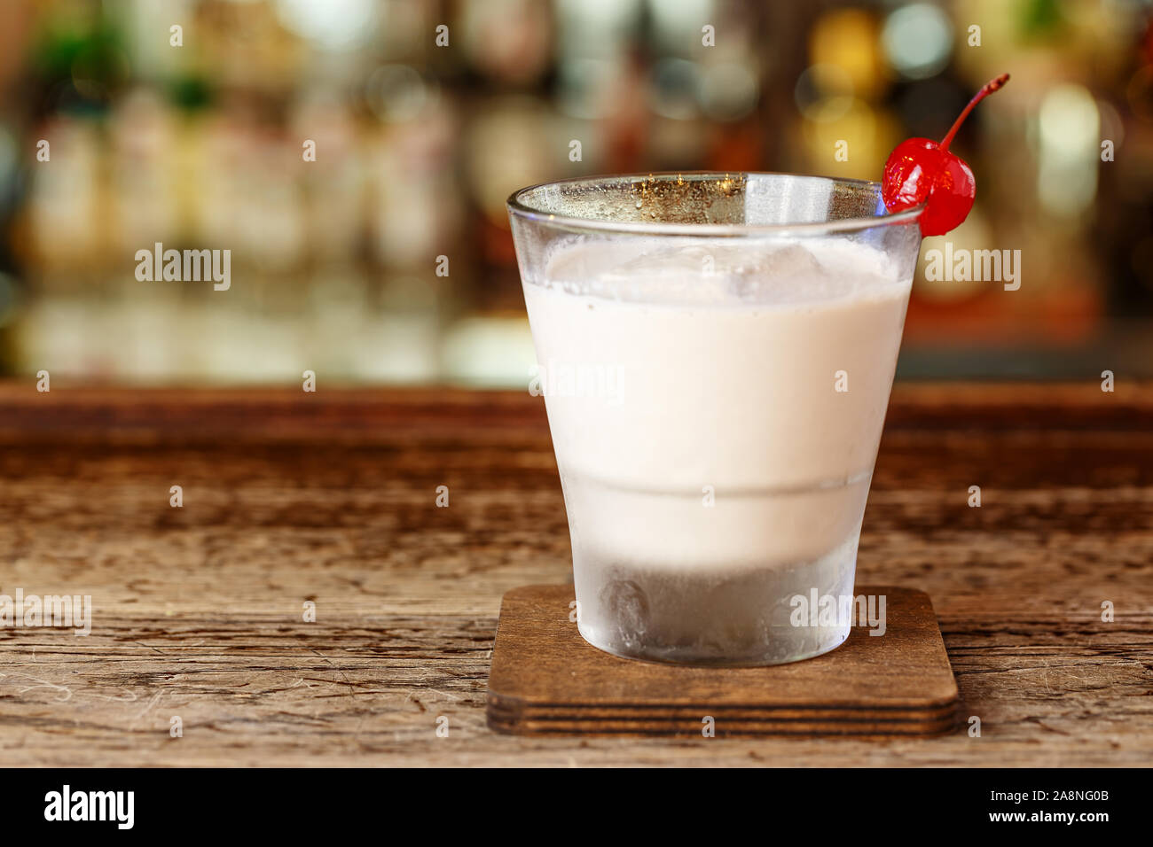 Milkshake with vodka is on the bar in the nightclub. Drinks party. Stock Photo
