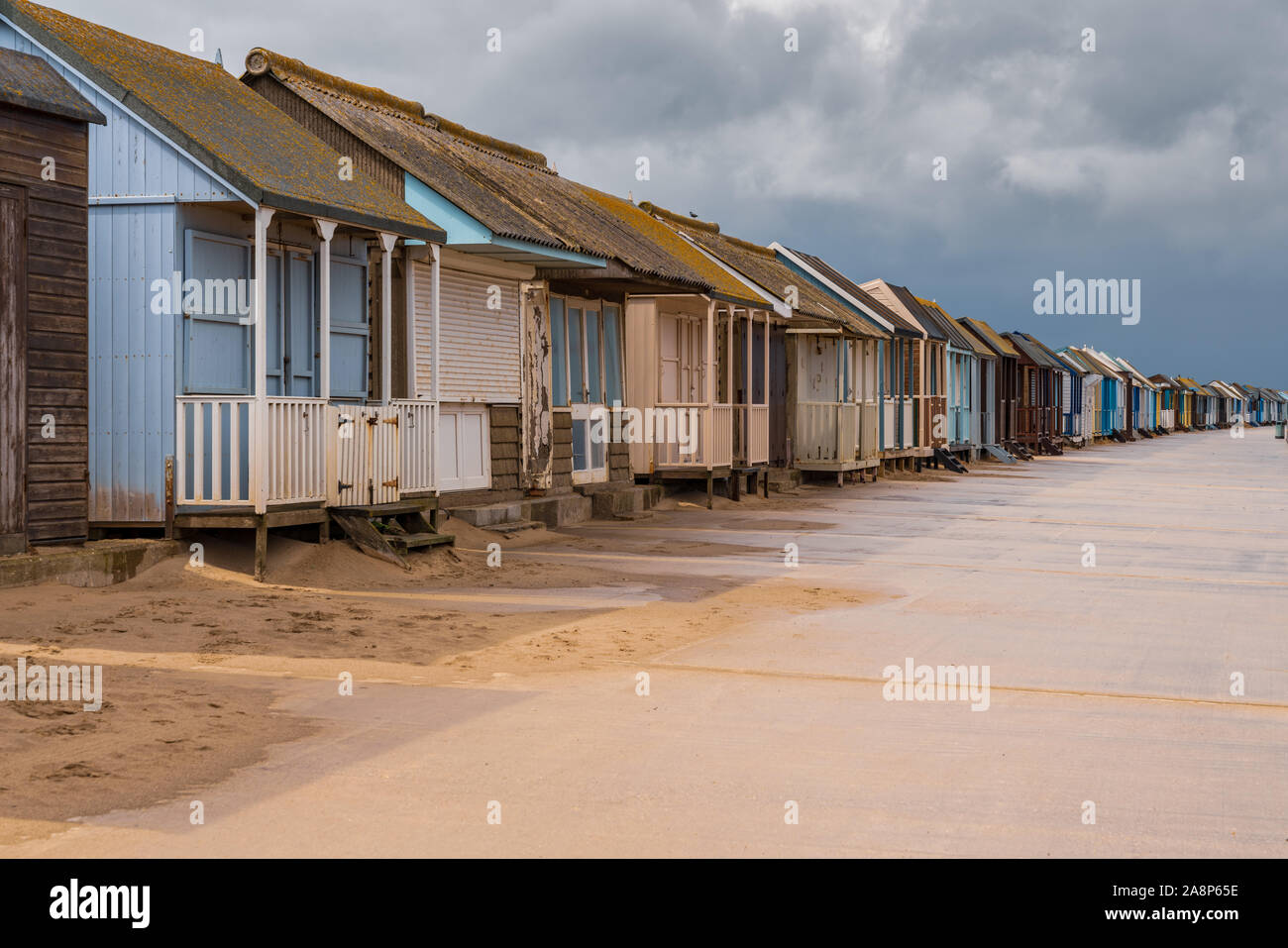 Grey clouds over the Beach Huts in Sandilands, Lincolnshire, England, UK Stock Photo