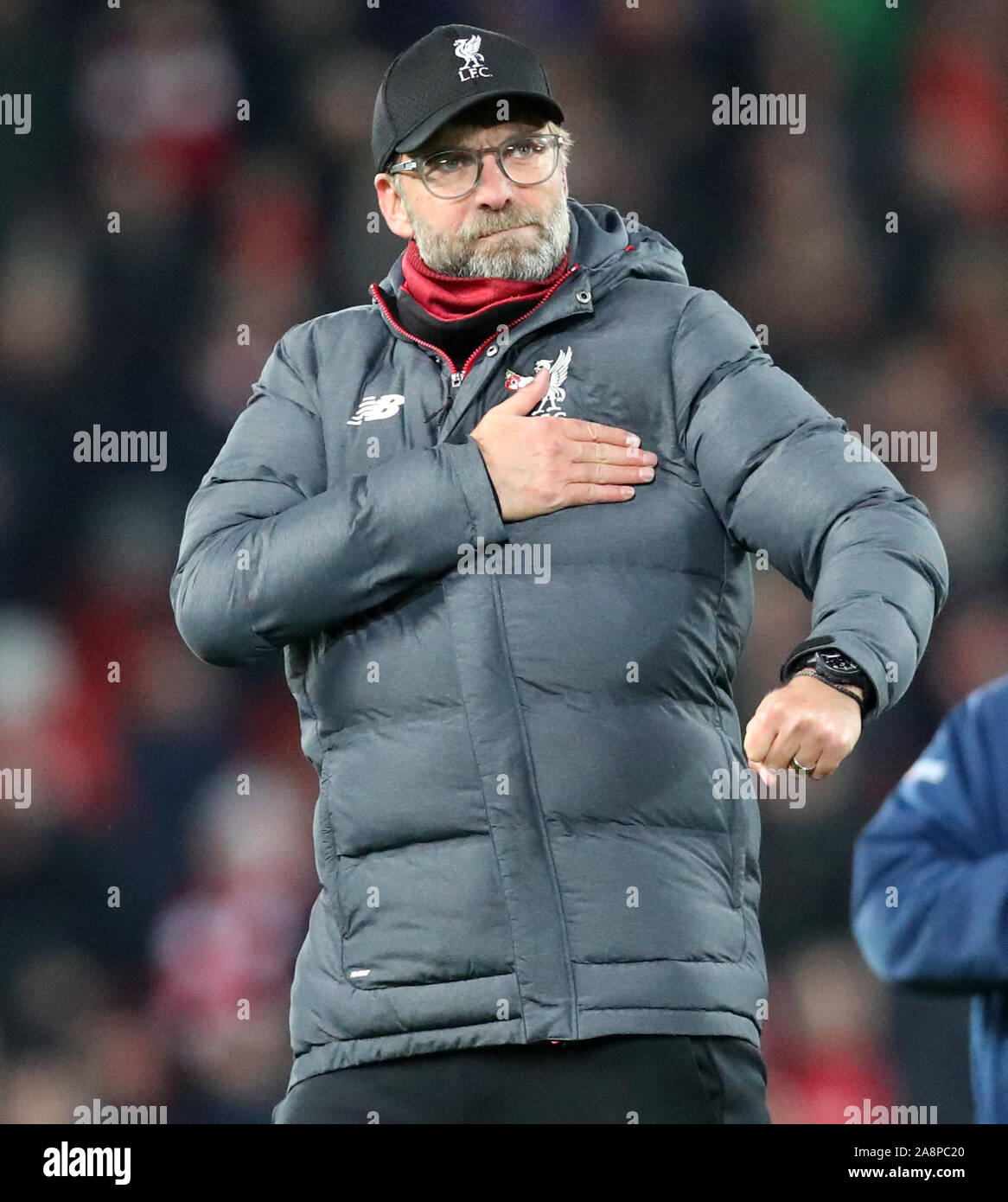 Anfield Liverpool Merseyside Uk 10th Nov 2019 English Premier League Football Liverpool Versus Manchester City Liverpool Manager Jurgen Klopp Pats The Club Crest On His Coat As He Leaves The Pitch After