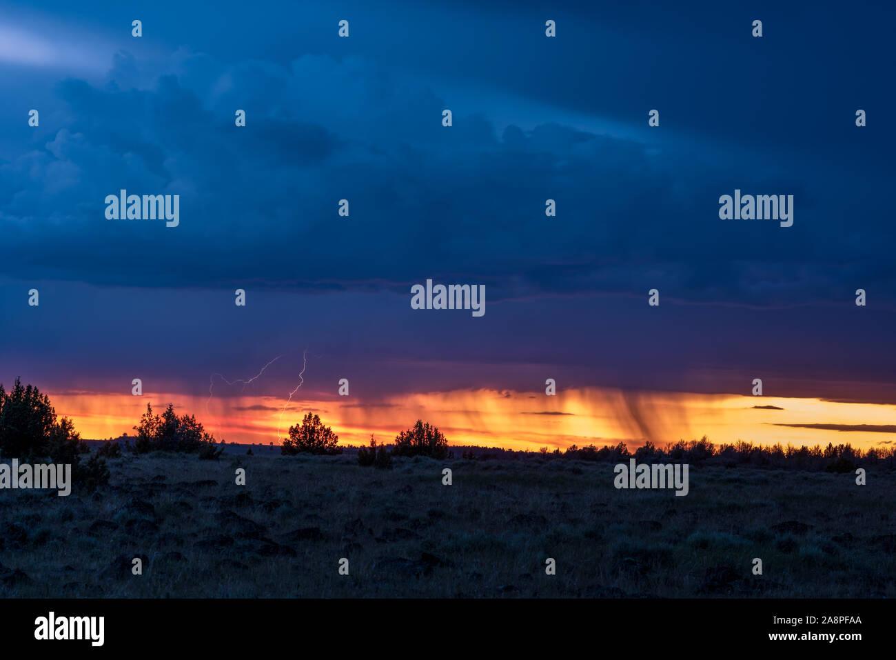 Lightning storm at sunset, Southeast Oregon. Stock Photo