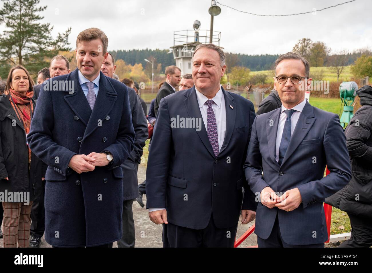 U.S. Secretary of State Mike Pompeo, center, during a walking tour of the remains of the Berlin Wall with German Foreign Minister Heiko Maas, right, November 7, 2019 in Modlareuth, Germany. Pompeo is in Germany to mark the 30th anniversary of the fall of the Berlin Wall. Stock Photo