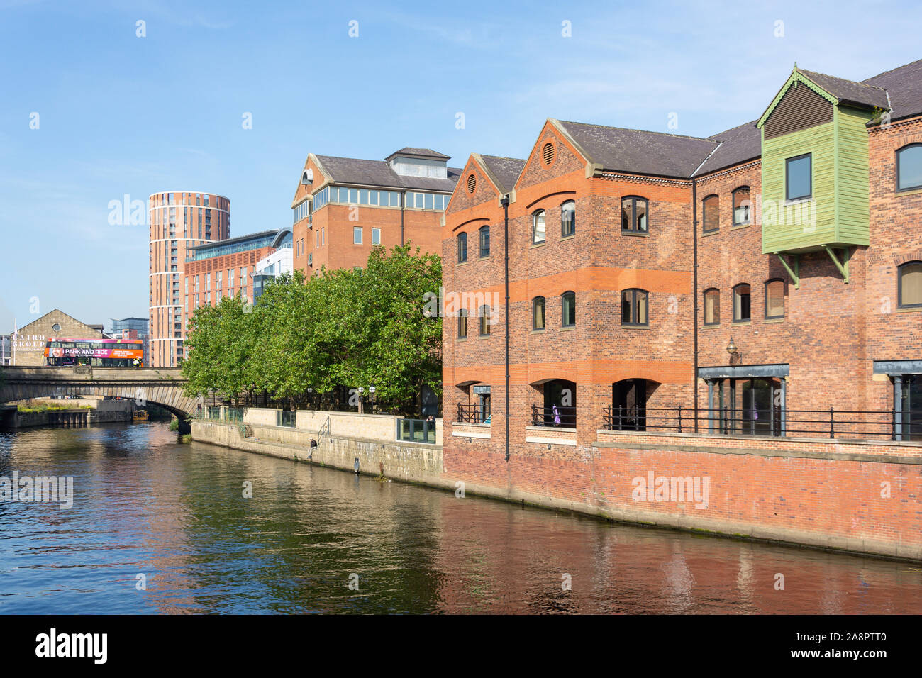 Victoria Bridge and warehouses across River Aire, Leeds, West Yorkshire, England, United Kingdom Stock Photo