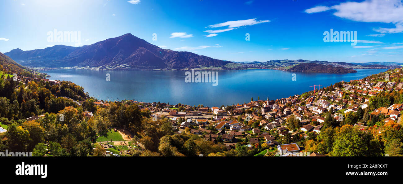 Aerial view of Walchwil town with colorful trees, Zugersee and Rigi mountain, Zug, Switzerland, Europe. Stock Photo