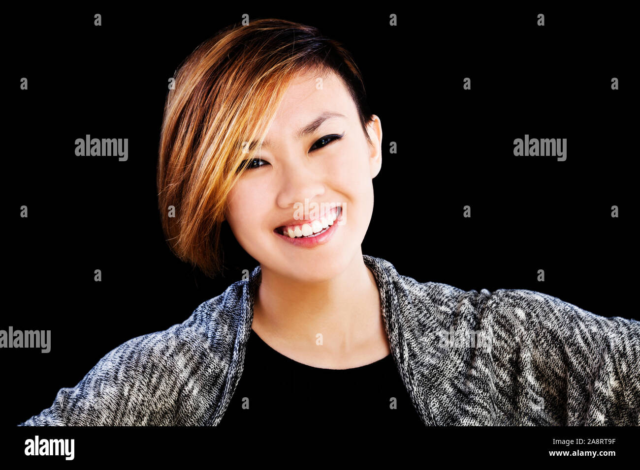 Horizontal Portrait Of Attractive Asian American Woman On Black Background Smiling Short Hair Stock Photo
