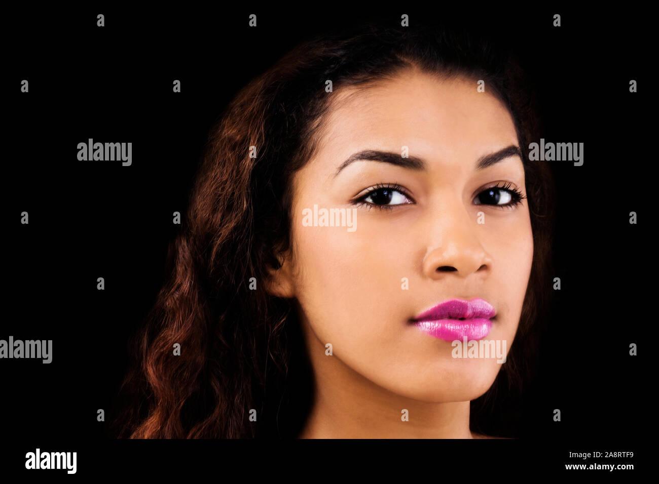 Horizontal Portrait Of Attractive Latina Woman On Black Background Stock Photo