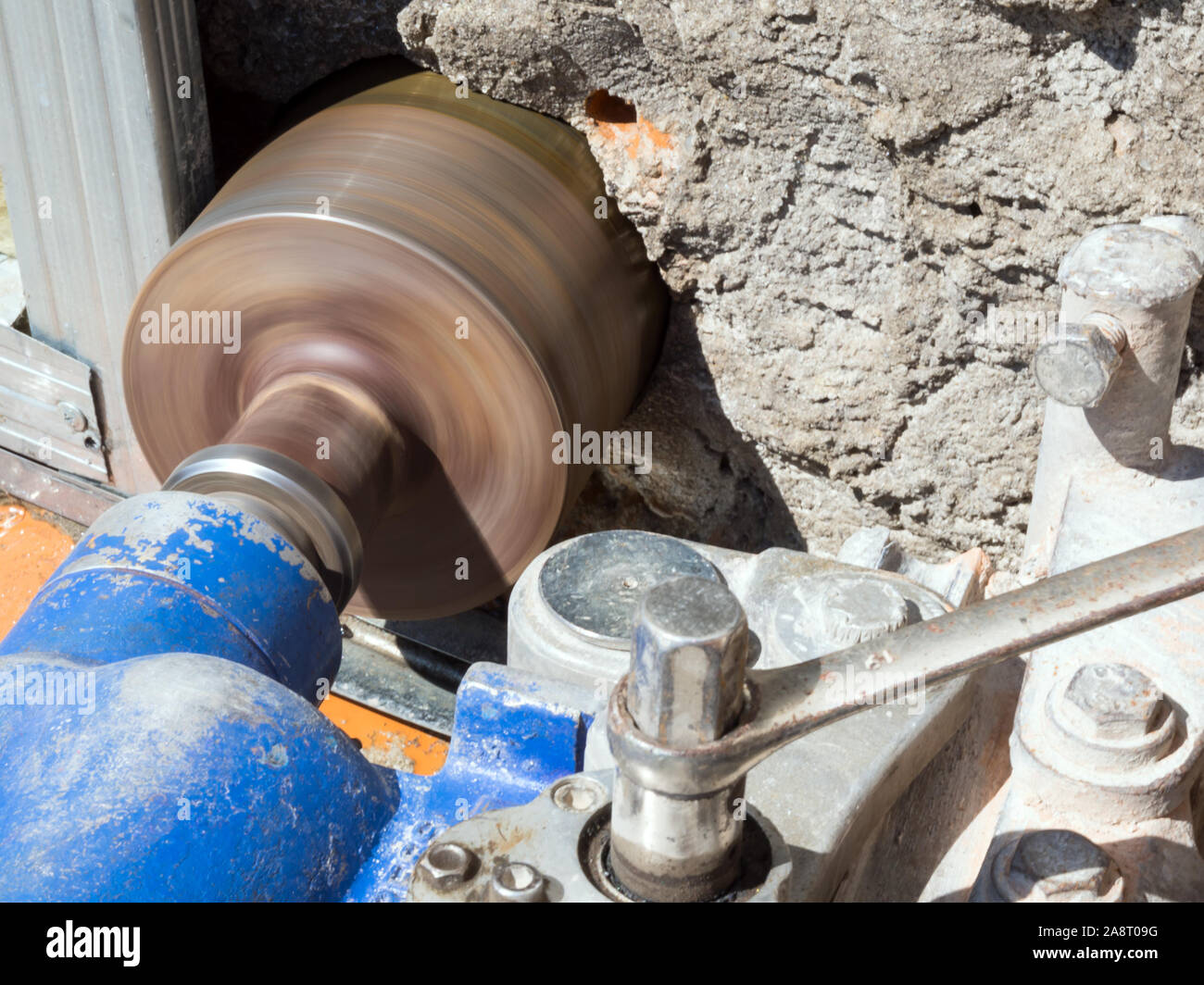 Device for drilling large diameter holes in operation Stock Photo