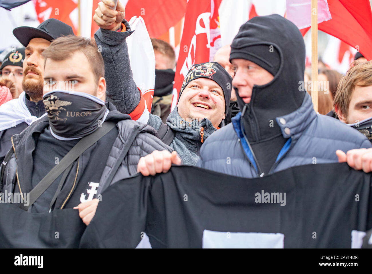 Warsaw / Poland - 11.11.2018: The Independece March. nationalists faces flags and symbols. National independence day, 100th anniversary. Stock Photo