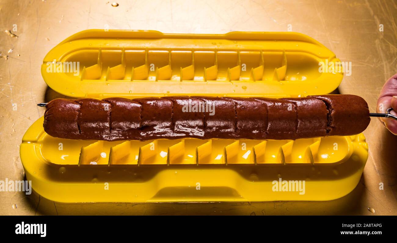 Curl A Dog Spiral Hotdog Slicer with hotdog Stock Photo