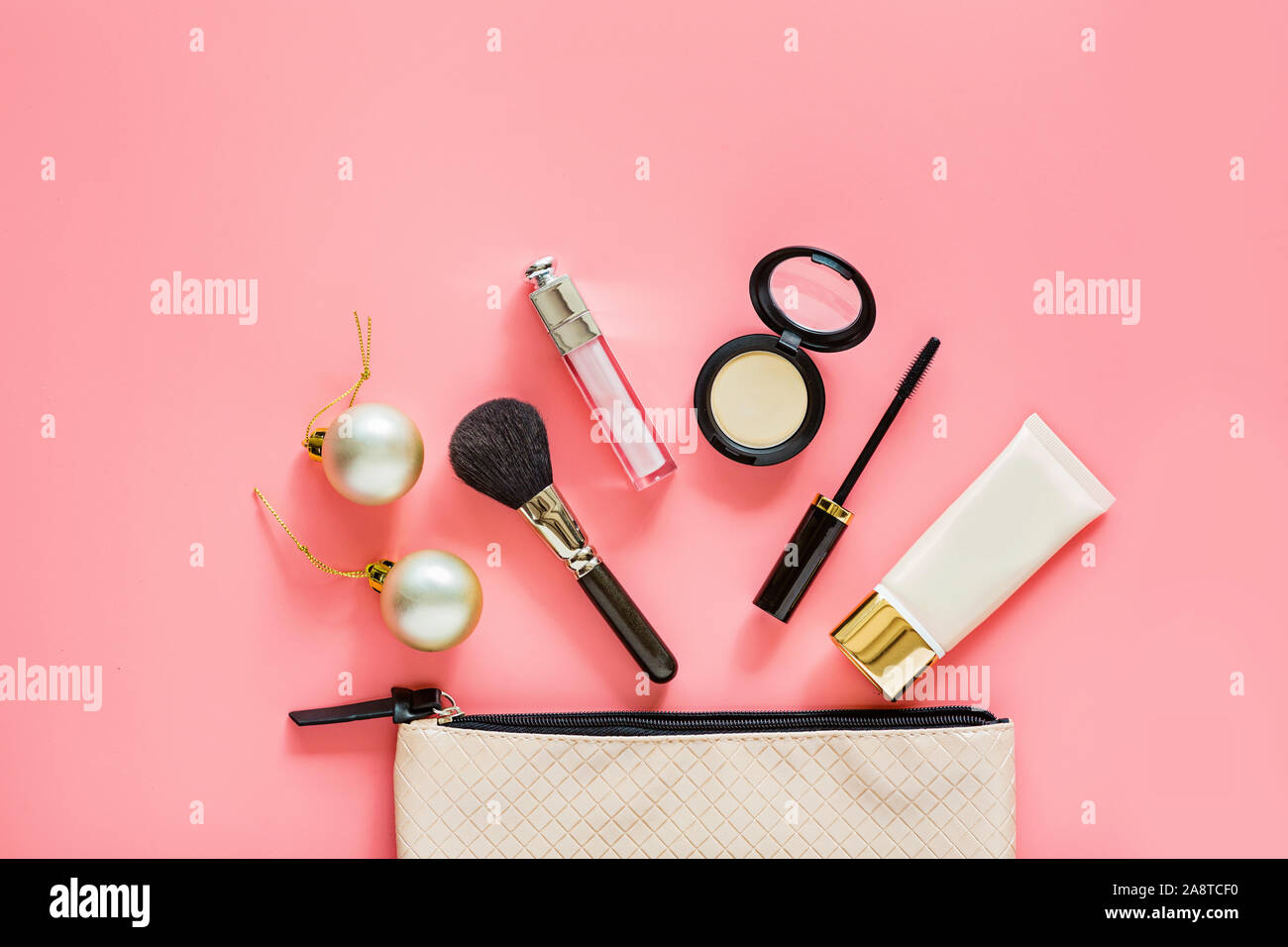 Christmas Makeup.Products 2020 Flat lay composition with makeup products and Christmas decor on