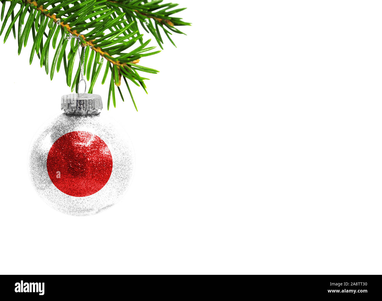 Glass Christmas ball toy isolated on white background with the flag of Japan Stock Photo