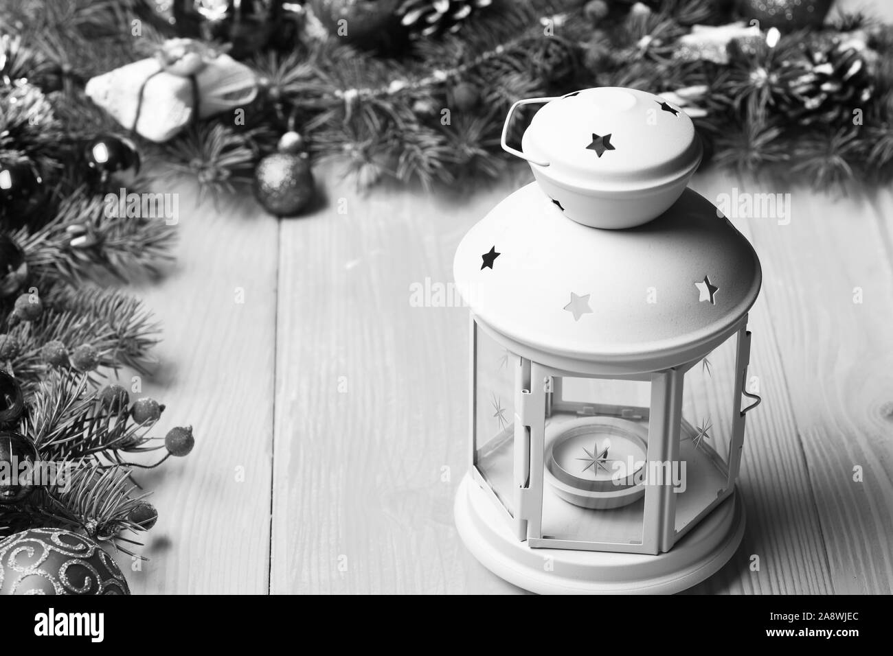 Winter Time And New Year Card Concept Composition Of Christmas Tree Decor Lantern In Romantic White Color Near Decorated Fir Tree Branches Christmas Decorations On Yellow Wooden Texture Background Stock Photo