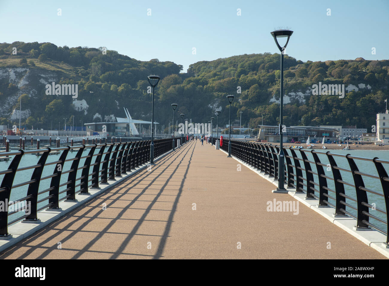 New promenade in the harbour of Dover next to the beach and the yacht harbour on a warm sunny day in late September. Stock Photo
