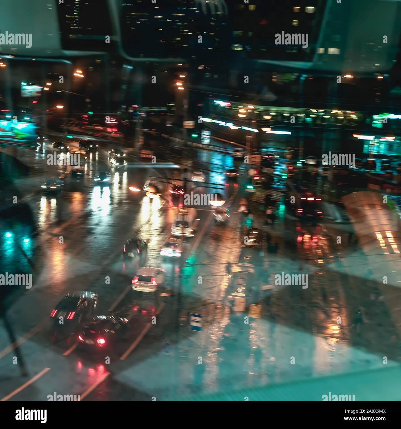 Abstract Blurred Illuminated Street At Rainy Night Traffic