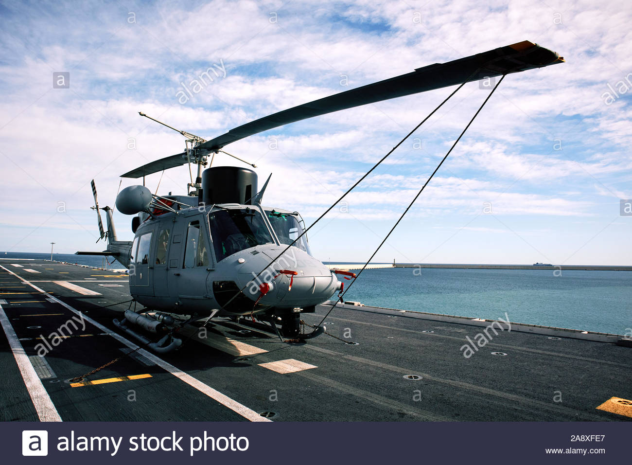 VALENCIA, SPAIN - NOVEMBER 2019: Helicopter on the deck of the ship Juan Carlos I (L-61), an amphibious assault ship of greater size and tonnage than Stock Photo