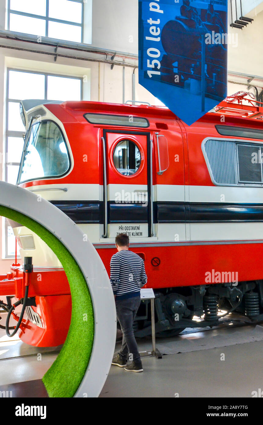 Pilsen, Czech Republic - Oct 28, 2019: Inside exhibition in the Techmania Science Center. Old red train locomotive as one of the exhibits. Center explaining scientific principles to children by game. Stock Photo