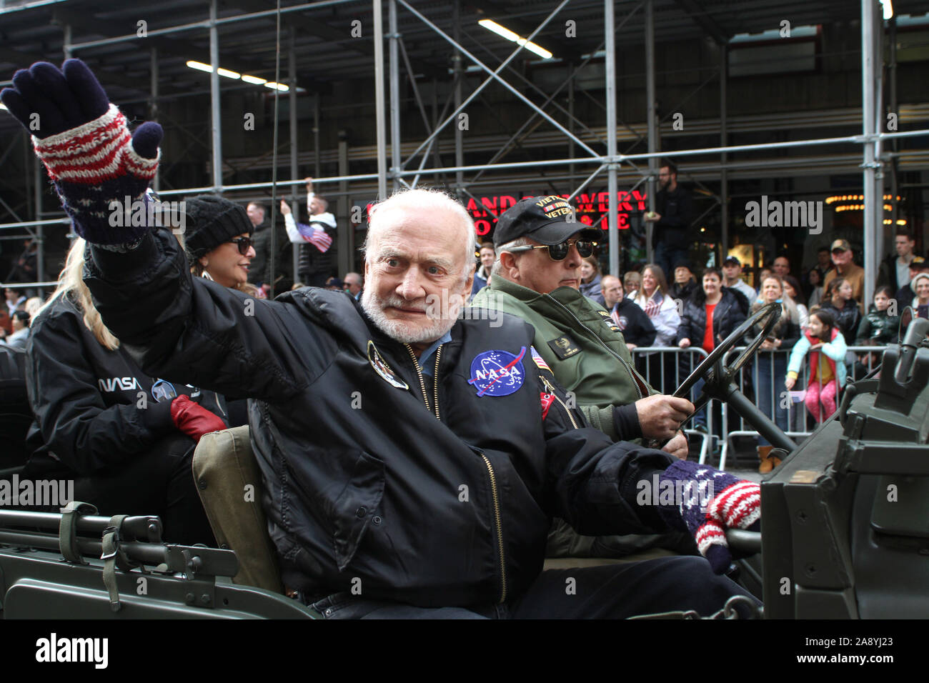 November 11, 2019, New York, New York, USA: President Donald Trump speaks at the 100th Annual Veteran's Day Parade in N.Y.C. after his speech there was a moment of .silence and then veterans marched up 5th Ave.Edwin ''Buzz'' Aldrin former Astronaut waves to the crowd. (Credit Image: © Bruce Cotler/Globe Photos via ZUMA Wire) Stock Photo