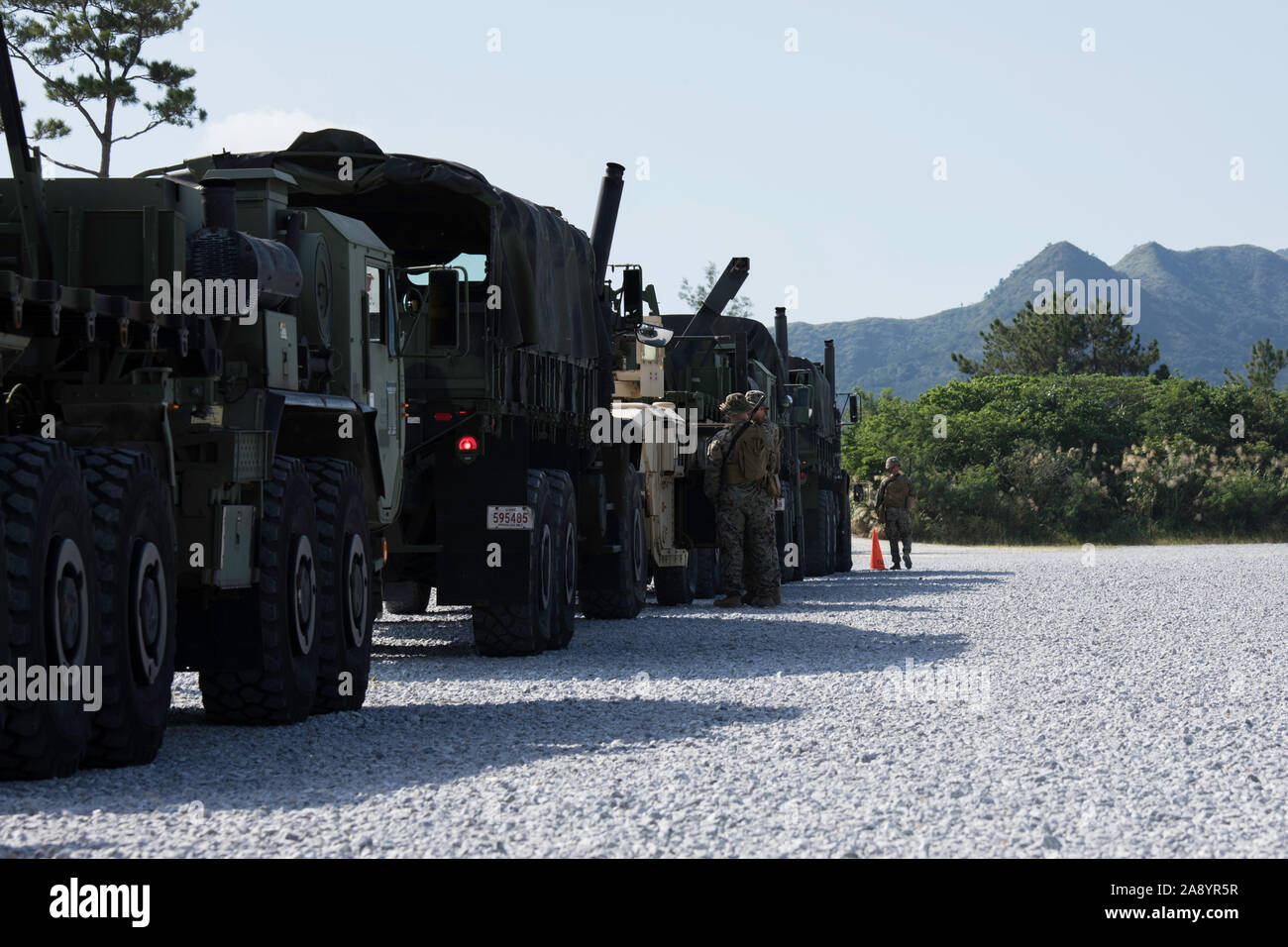 U.S. Marines inspect their vehicles after a convoy during a field exercise on Camp Hansen, Okinawa, Japan, Nov.  5, 2019. Motor Transport Company, 3rd Transportation Support Battalion, Combat Logistics Regiment 3, 3rd Marine Logistics Group focused on improving their tactical skills to include convoy operations, movement control, equipment familiarization and mission planning during the FEX. (U.S. Marine Corps photo by Pfc. Courtney A. Robertson) Stock Photo