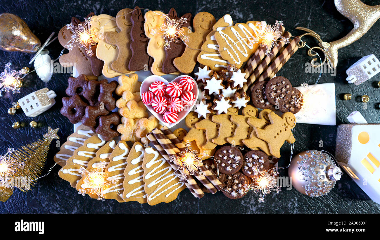 Happy Holidays Christmas Large Dessert Grazing Platter Charcuterie Board With Gingerbread Chocolate And Shortbread Cookies With Black And Gold Theme Stock Photo Alamy