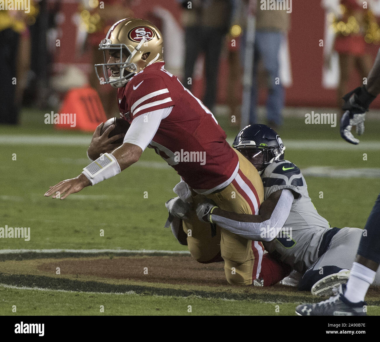 Santa Clara, California, USA . 11th Nov, 2019. San Francisco 49ers quarterback Jimmy Garoppolo (10) is sacked by the Seattle Seahawks in the first quarter at Levi's Stadium in Santa  Clara, California on Monday, November 11, 2019. The Seahawks defreated the 49ers 27-24 in overtime.    Photo by Terry Schmitt/UPI Credit: UPI/Alamy Live News Stock Photo