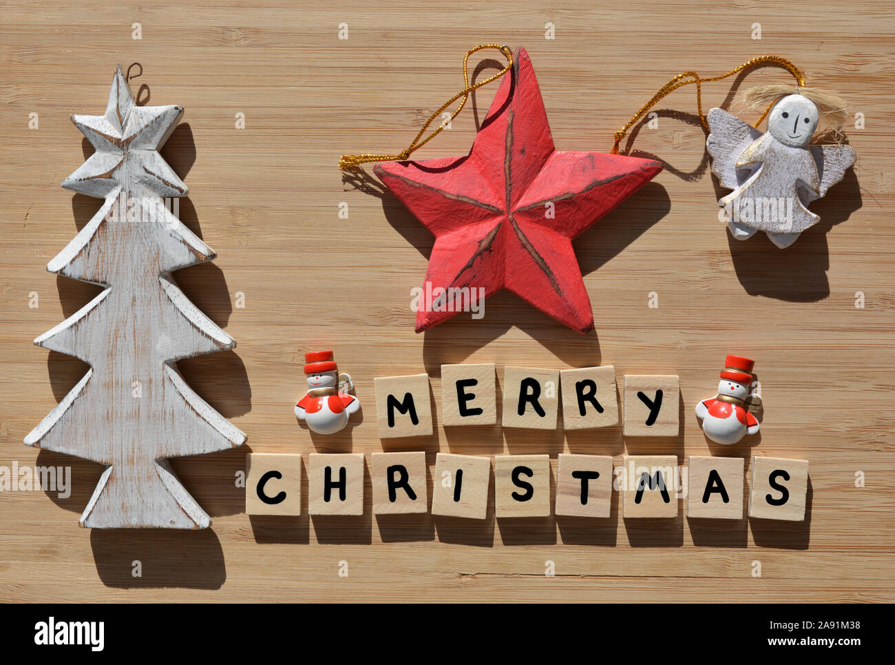 Merry Christmas In 3d Wooden Alphabet Letters With A Wooden Christmas Tree Reindeer And Santa Snowmen Decorations On A Bamboo Wood Background With Co Stock Photo Alamy
