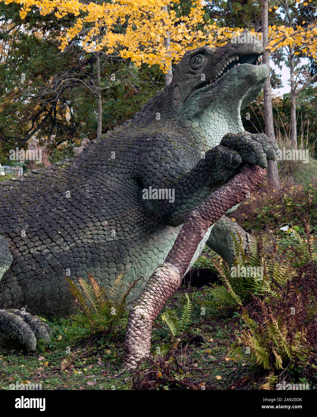 A dinosaur sculpture in Crystal Palace Park in London. These are the first dinasour sculptures in the world - inaccurate by modern science knowledge. Stock Photo