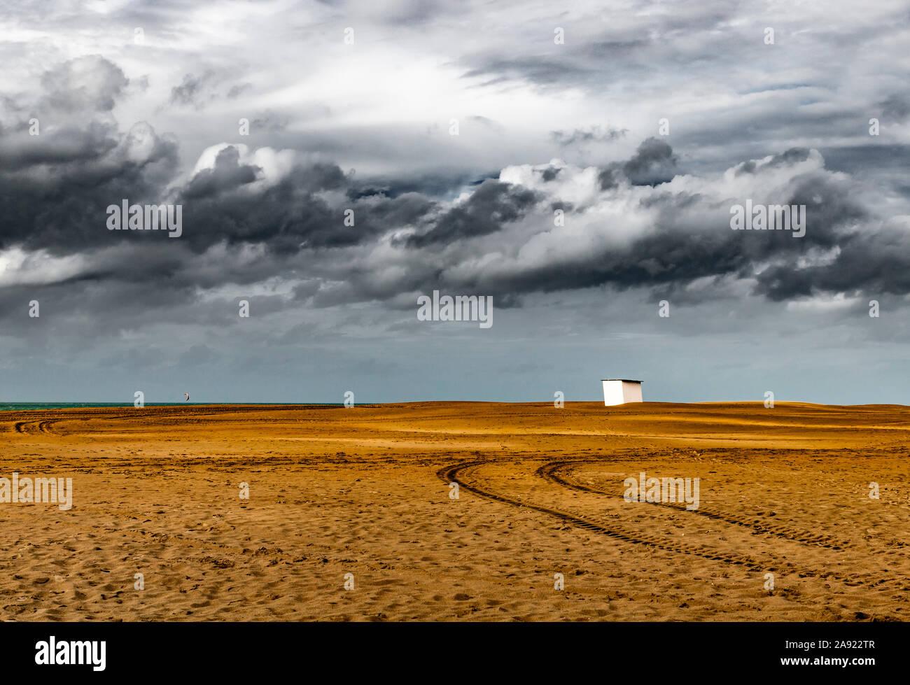 Oostduinkerke, Belgium (September 27, 2019): Lonely beach cabin onder a stormy sky Stock Photo