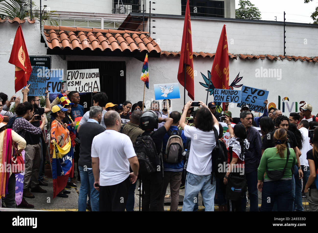 Crowd of supporters at the Bolivian embassy during the protest.Supporters of social movements and Venezuelan communist youth protest in support of former president, Evo Morales in front of the Bolivian embassy. The president of the country resigned after strong protests against his re-election and for refusing to conduct an audit of votes. Stock Photo