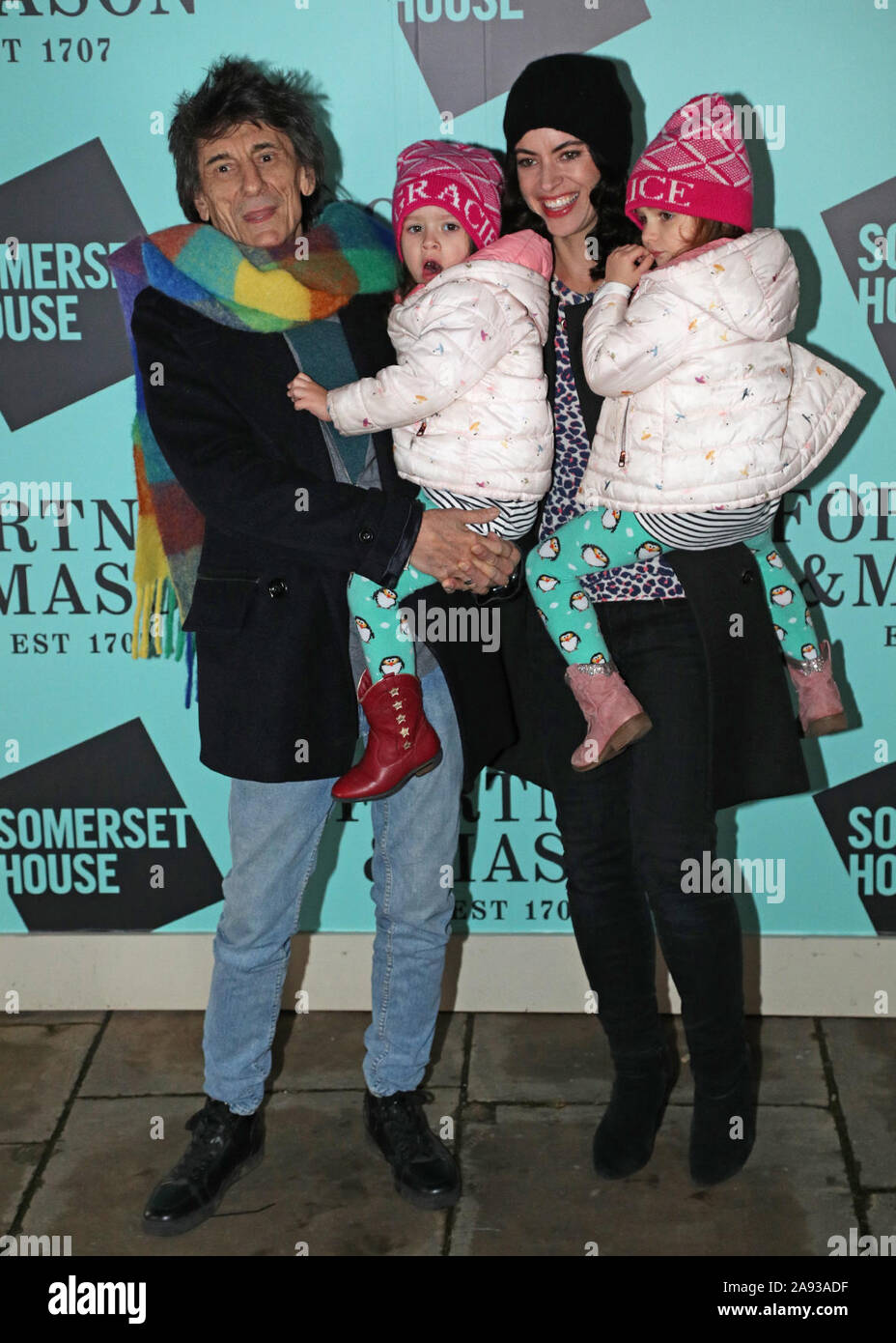 billigt till salu ankommer någonsin populär Ronnie Wood with his wife Sally Humphreys and their two daughters ...