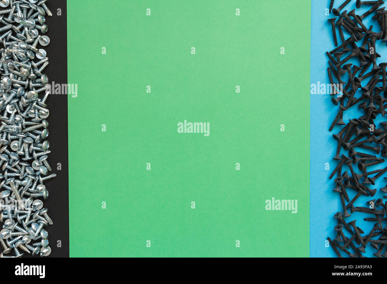 Flat Lay Composition With Different Screws on Black, Green and Blue Background. Top View of Checklist Concept Stock Photo