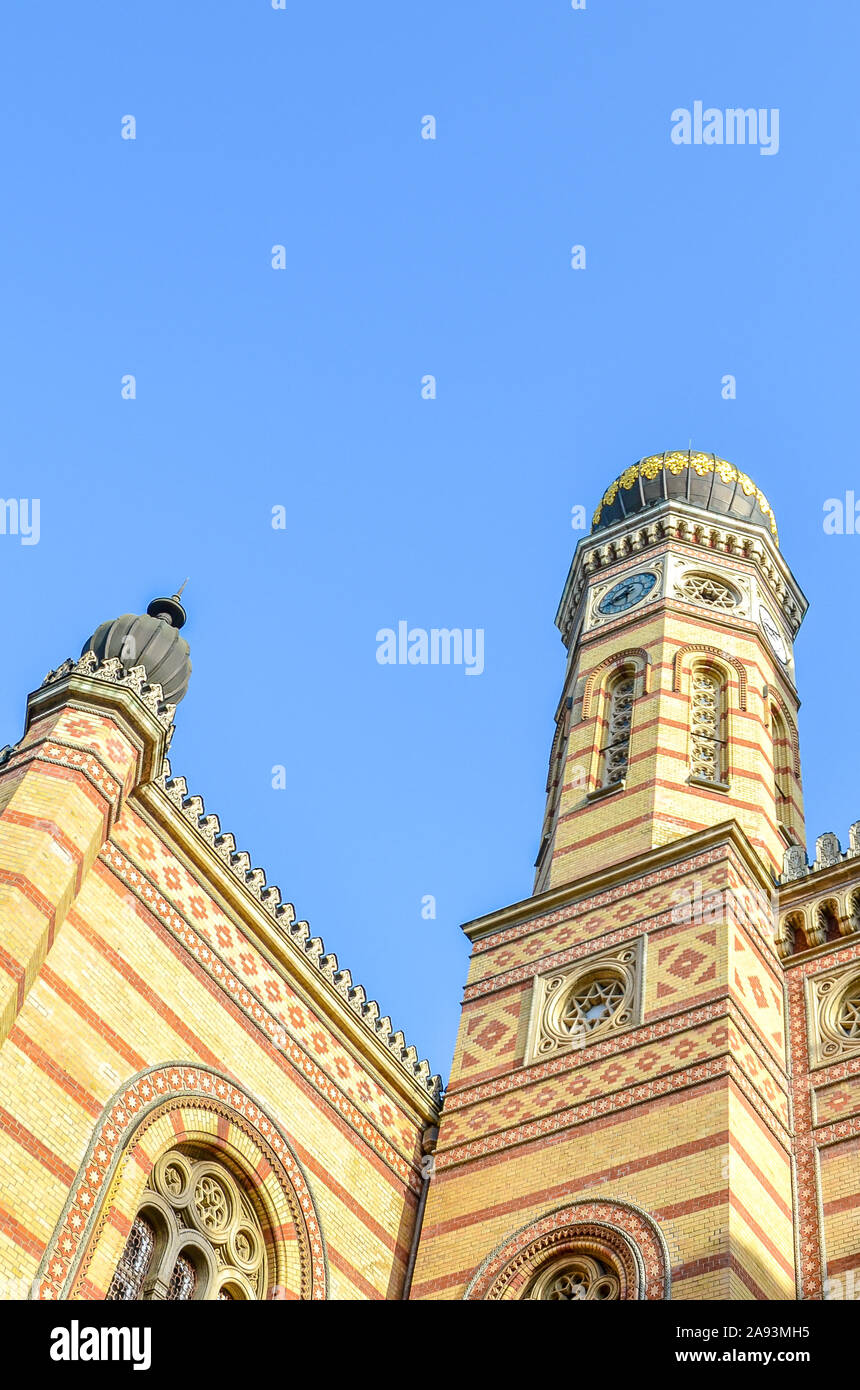 Vertical photo of the Great Synagogue in Budapest, Hungary. Known also as Dohany Street Synagogue, the largest synagogue in Europe. Centre of Neolog Judaism. Ornamental facade and a onion dome. Stock Photo