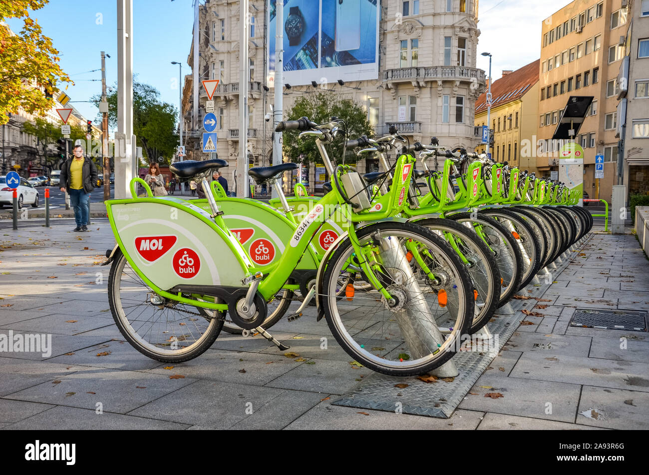 Budapest, Hungary - Nov 6, 2019: Public green bikes for rental in the center of the Hungarian capital. Bike sharing. Eco-friendly means of transport. Ecological measure in the cities. Bicycles. Stock Photo