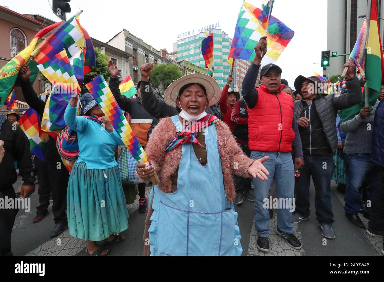 La Paz, Bolivia. 12th Nov, 2019. Supporters of the former president of Bolivia, Evo Morales, demonstrate in La Paz, Bolivia 12 November 2019, carrying the Whipala, a flag that represents the country's indigenous. Credit: Martin Alipaz/EFE/Alamy Live News Stock Photo