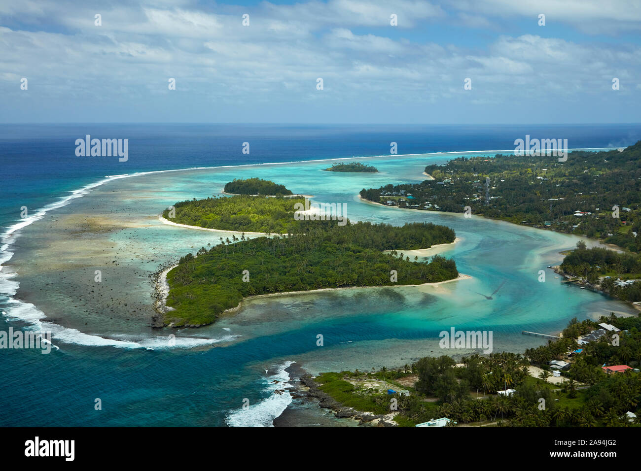 Avana Harbour, Muri Lagoon (said to be where Maori left for their historic voyage to New Zealand), Rarotonga, Cook Islands, South Pacific - aerial Stock Photo